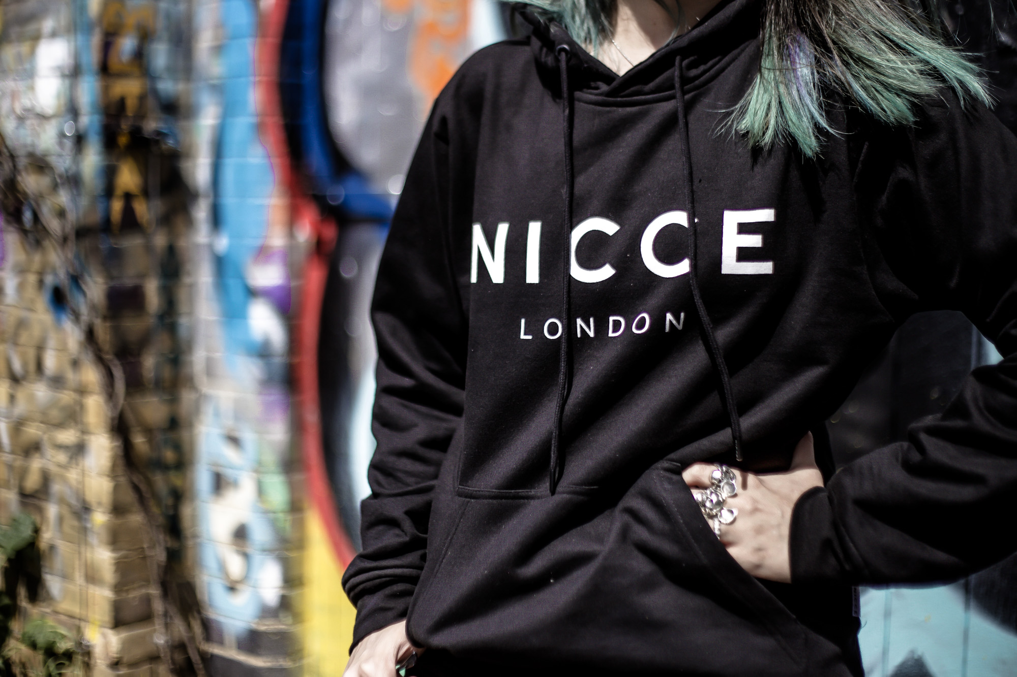 NICCE London Hoodie Close Up Logo