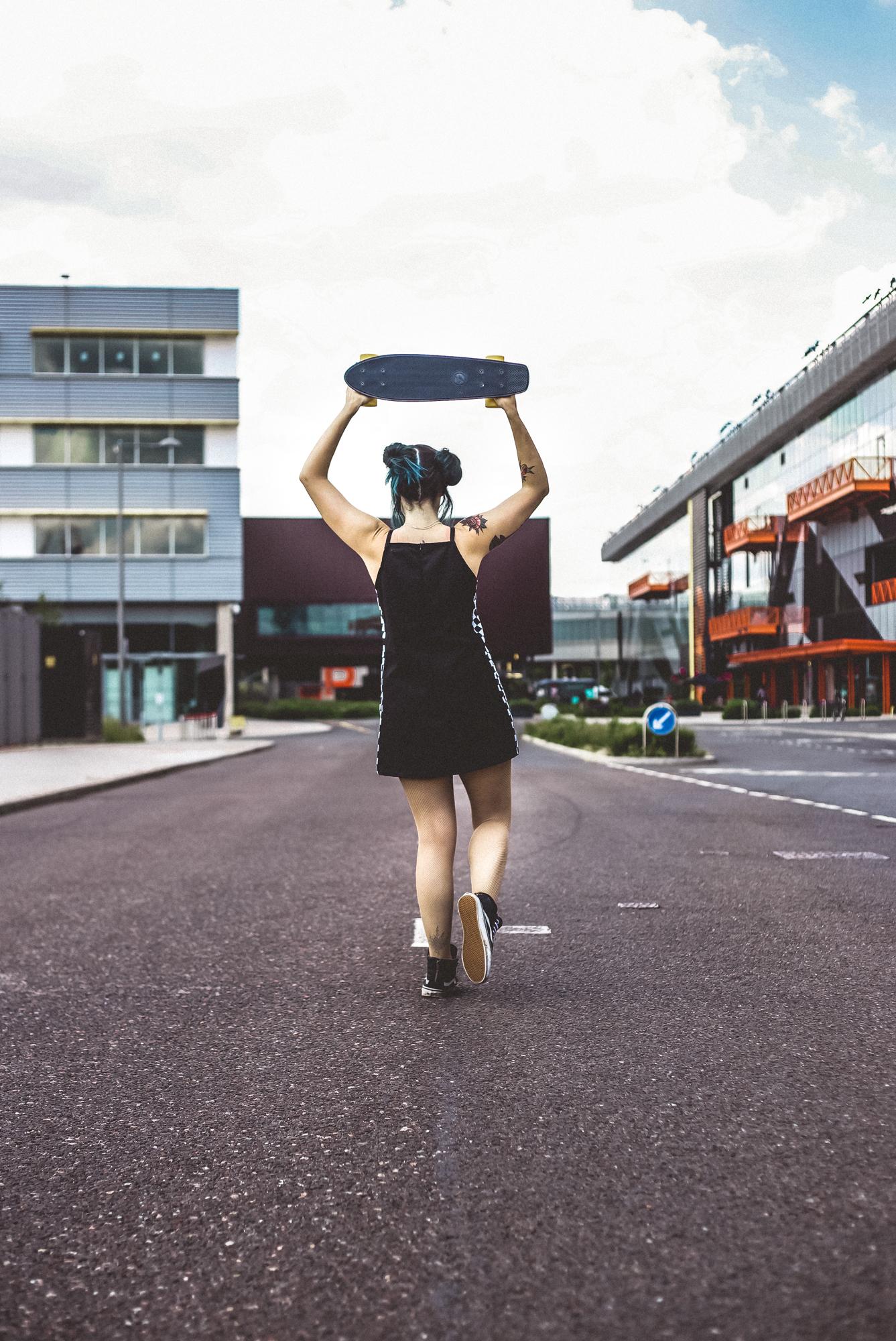 Emma Inks alternative style with skateboard in stratford