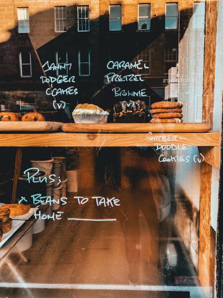 Brew'd by Source Coffee Shop Vegan Baked Goods in Window - Edinburgh Coffee Shops by Emma Inks